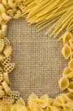 Raw pasta on sack burlap background Royalty Free Stock Photos
