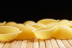 Raw pasta shells Stock Images