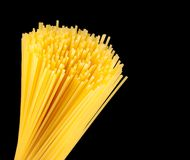Raw pasta spaghetti on black background with space for text Stock Photo