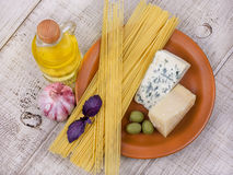 Raw pasta spaghetti and cheese Royalty Free Stock Photo