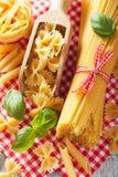 Raw pasta spaghetti farfalle penne italian cuisine Stock Photography