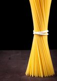 Raw pasta spaghetti on wood table with space for text Stock Images