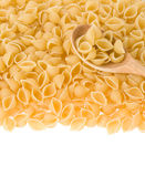 Raw pasta and spoon Stock Photos