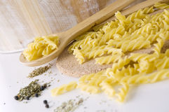 Raw pasta on spoon Stock Photo