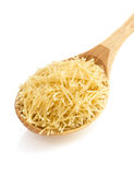 Raw pasta in spoon on white Stock Photography
