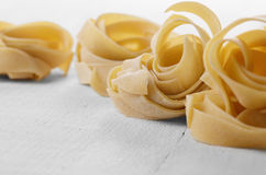 Raw pasta tagliatelle Royalty Free Stock Image