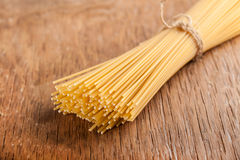 Raw pasta tied with a rope Royalty Free Stock Image