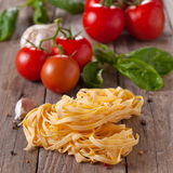 Raw pasta with tomato Stock Photos