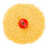 Raw pasta with tomato isolated on white Royalty Free Stock Photos