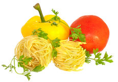 Raw pasta with tomato, pepper and greens isolated Royalty Free Stock Photos