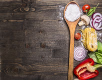 Raw pasta with tomatoes, basil,parmesan and oil, cooking Ingredients on rustic wooden background, top view, place for text Royalty Free Stock Photos
