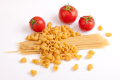 Raw pasta and tomatoes Royalty Free Stock Image