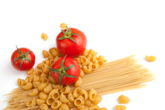 Raw pasta and tomatoes. Raw pasta with cherry tomatoes with white space for your text here Royalty Free Stock Images
