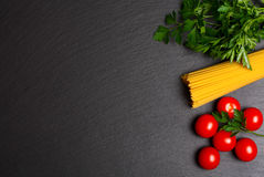 Raw pasta with tomatoes and parsley.  Royalty Free Stock Photo