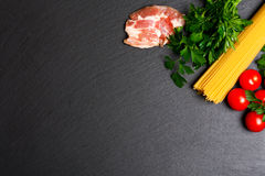Raw pasta with tomatoes and parsley.  Royalty Free Stock Photography