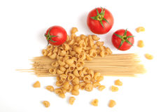 Raw pasta and tomatoes. Raw pasta and ingredients with tomatoes Stock Photography