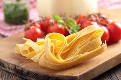 Raw pasta and vegetables Royalty Free Stock Photos