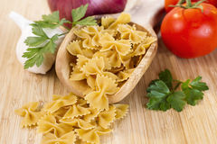 Raw Pasta with vegetables and herbs Royalty Free Stock Photos