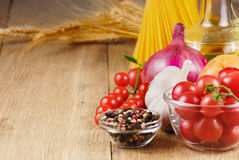 Raw pasta,vegetables, oil and spices Royalty Free Stock Image