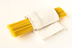 Raw pasta in a white towel diagonal Royalty Free Stock Photo