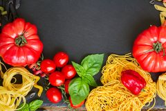Free Raw Pasta With Ingridients On Black Board Royalty Free Stock Photos - 57448888