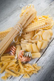 Raw pasta on wood Royalty Free Stock Images
