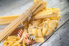 Raw pasta on wood Stock Image