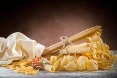 Raw pasta on wood Stock Image
