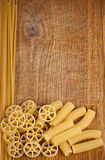 Raw pasta on wood background Royalty Free Stock Photos