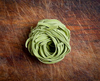Raw pasta on wood background Royalty Free Stock Image