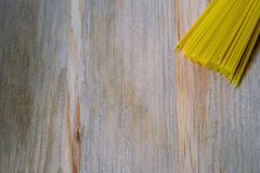 Raw pasta on wood background texture Stock Photography