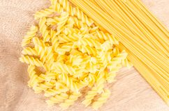 Raw pasta on wooden background Royalty Free Stock Image
