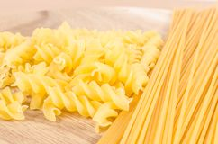 Raw pasta on wooden background Royalty Free Stock Images