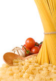 Raw pasta and wooden spoon isolated Royalty Free Stock Image