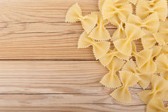 Raw pasta. On a wooden table Stock Images