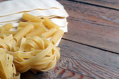 Raw pasta on a wooden table Royalty Free Stock Image