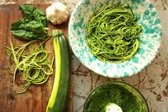Raw pasta with zucchini and spinach pesto with garlic