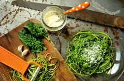 Raw pasta with zucchini and spinach pesto with garlic Stock Image