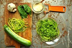 Raw pasta with zucchini and spinach pesto with garlic Stock Photos