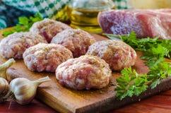 Raw patties from ground beef Stock Photos