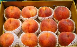 Raw peaches at local market. Raw peaches for sale at local market in Hakodate, Japan Stock Photos