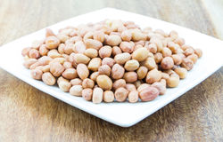 Raw peanuts or arachis. Bowl brown Stock Image