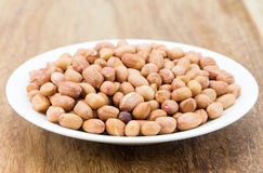 Raw peanuts or arachis. On  wood Royalty Free Stock Photography