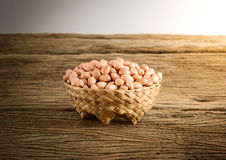Raw peanuts in basket Weave Wood Royalty Free Stock Image