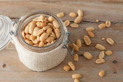 Raw peanuts in glass jar Royalty Free Stock Photography