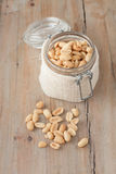 Raw peanuts in glass jar Stock Images