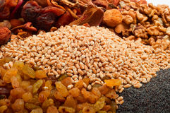 Raw pearl barley with dried fruits, raisins, nuts, poppy seeds Stock Photo