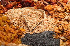 Raw pearl barley with iron form heart-dried fruits, raisins, nut Stock Photos