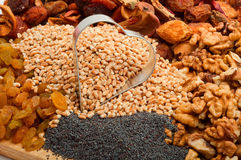 Raw pearl barley with iron form heart-dried fruits, raisins, nut Royalty Free Stock Photos