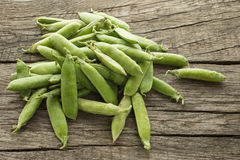 Raw peas on a heap Stock Photography